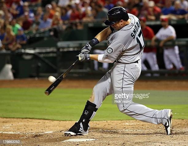 Justin Smoak of the Seattle Mariners hits a solo run home run in the ninth inning against the Texas Rangers at Rangers Ballpark in Arlington on...