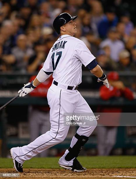 Justin Smoak of the Seattle Mariners hits an RBI single in the third inning against the Los Angeles Angels of Anaheim on Opening Day at Safeco Field...