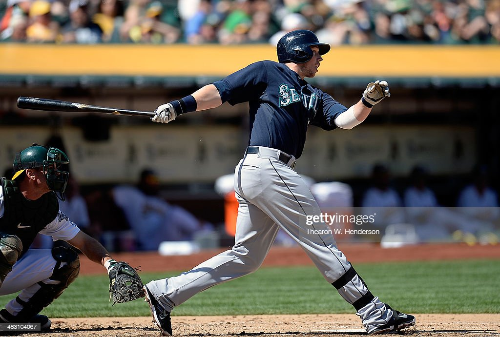 <a gi-track='captionPersonalityLinkClicked' href=/galleries/search?phrase=Justin+Smoak&family=editorial&specificpeople=2350583 ng-click='$event.stopPropagation()'>Justin Smoak</a> #17 of the Seattle Mariners hits an RBI single scoring Robinson Cano #22 (not pictured) against the Oakland Athletics in the top of the third inning at O.co Coliseum on April 6, 2014 in Oakland, California.