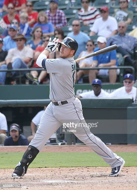 Justin Smoak of the Seattle Mariners hits in the ninth inning against the Texas Rangers at Globe Life Park in Arlington on September 7 2014 in...