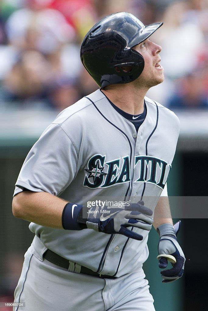 <a gi-track='captionPersonalityLinkClicked' href=/galleries/search?phrase=Justin+Smoak&family=editorial&specificpeople=2350583 ng-click='$event.stopPropagation()'>Justin Smoak</a> #17 of the Seattle Mariners watches a pop fly to center field for an out during the ninth inning against the Cleveland Indians at Progressive Field on May 19, 2013 in Cleveland, Ohio. The Indians defeated the Mariners 6-0.
