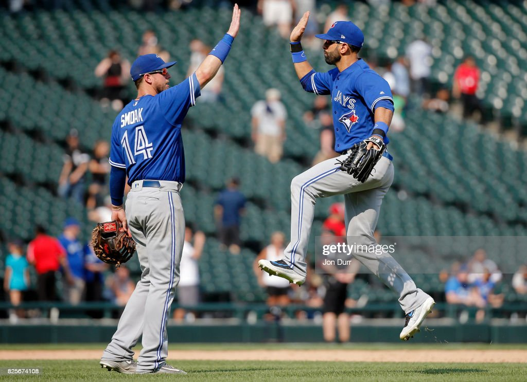 Justin Smoak #14 of the Toronto Blue Jays (L) and Jose Bautista #19 celebrate their win over the Chicago White Sox at Guaranteed Rate Field on August 2, 2017 in Chicago, Illinois. The Toronto Blue Jays won 5-1.