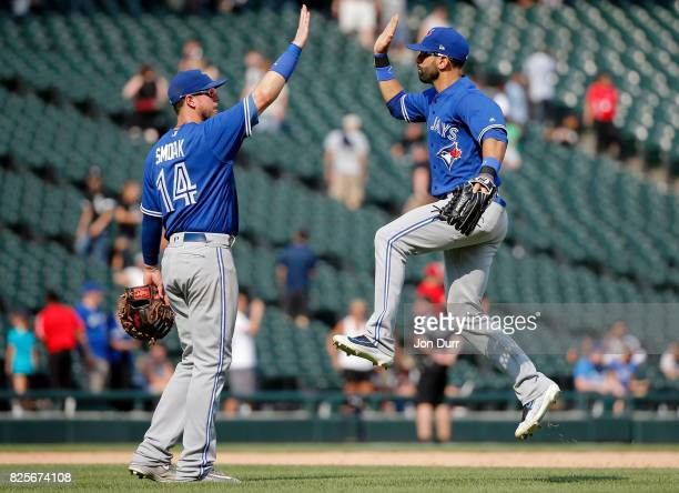 Justin Smoak of the Toronto Blue Jays and Jose Bautista celebrate their win over the Chicago White Sox at Guaranteed Rate Field on August 2 2017 in...