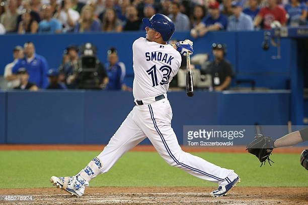 Justin Smoak of the Toronto Blue Jays bats in the eighth inning during MLB game action against the New York Yankees on August 14 2015 at Rogers...