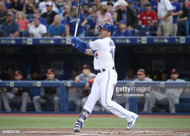 Justin Smoak of the Toronto Blue Jays bats in the first inning during MLB game action against the Baltimore Orioles at Rogers Centre on September 12...