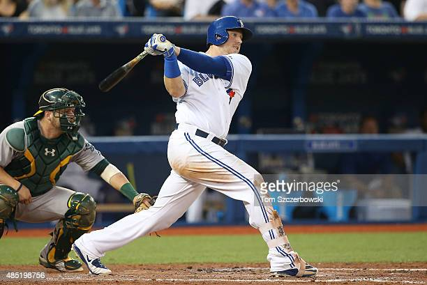 Justin Smoak of the Toronto Blue Jays bats in the fourth inning during MLB game action against the Oakland Athletics on August 11 2015 at Rogers...