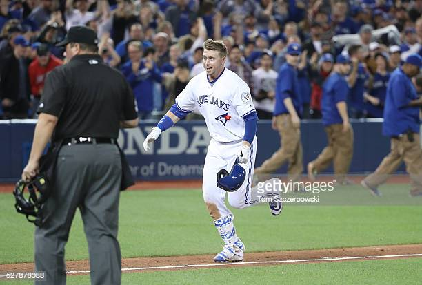 Justin Smoak of the Toronto Blue Jays celebrates after hitting a gamewinning solo home run in the tenth inning during MLB game action against the...