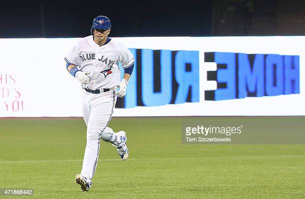 Justin Smoak of the Toronto Blue Jays circles the bases after hitting a tworun home run in the fourth inning during MLB game action against the...