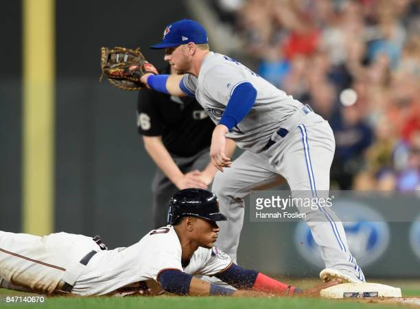 Justin Smoak of the Toronto Blue Jays doubles Jorge Polanco of the Minnesota Twins off first base during the fifth inning of the game on September 14...