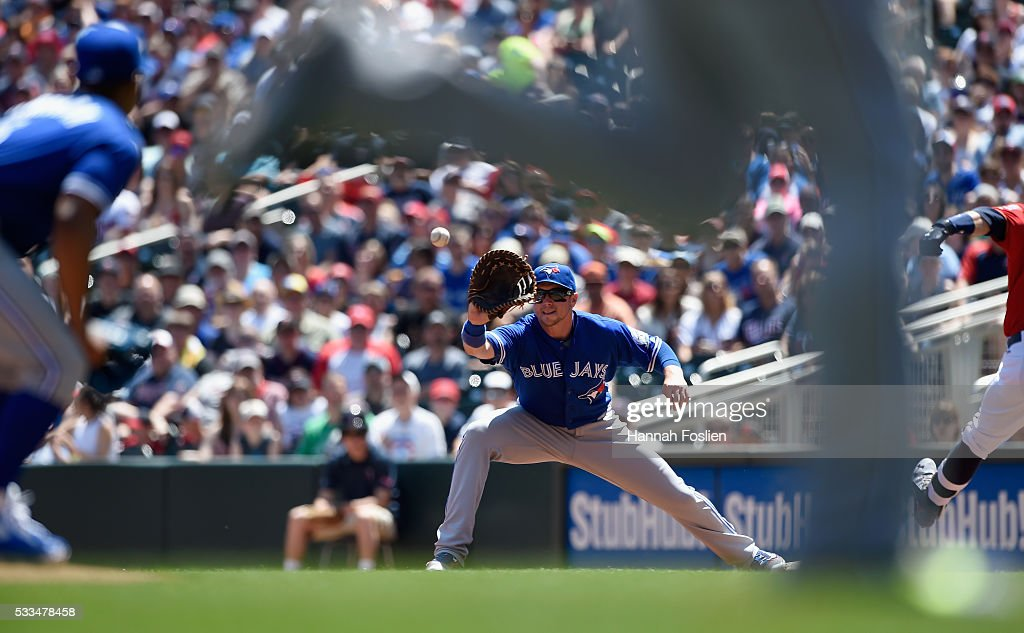 <a gi-track='captionPersonalityLinkClicked' href=/galleries/search?phrase=Justin+Smoak&family=editorial&specificpeople=2350583 ng-click='$event.stopPropagation()'>Justin Smoak</a> #14 of the Toronto Blue Jays fields a throw from <a gi-track='captionPersonalityLinkClicked' href=/galleries/search?phrase=Josh+Donaldson&family=editorial&specificpeople=4959442 ng-click='$event.stopPropagation()'>Josh Donaldson</a> #20 at third base to get <a gi-track='captionPersonalityLinkClicked' href=/galleries/search?phrase=Brian+Dozier&family=editorial&specificpeople=7553002 ng-click='$event.stopPropagation()'>Brian Dozier</a> #2 of the Minnesota Twins out at first base as pitcher <a gi-track='captionPersonalityLinkClicked' href=/galleries/search?phrase=Marcus+Stroman&family=editorial&specificpeople=7916987 ng-click='$event.stopPropagation()'>Marcus Stroman</a> #6 looks on during the first inning of the game on May 22, 2016 at Target Field in Minneapolis, Minnesota.