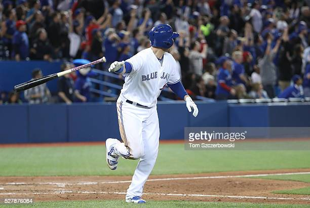 Justin Smoak of the Toronto Blue Jays hits a gamewinning solo home run in the tenth inning during MLB game action against the Texas Rangers on May 3...