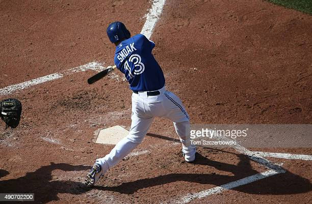 Justin Smoak of the Toronto Blue Jays hits a single in the fourth inning during MLB game action against the Tampa Bay Rays on September 26 2015 at...
