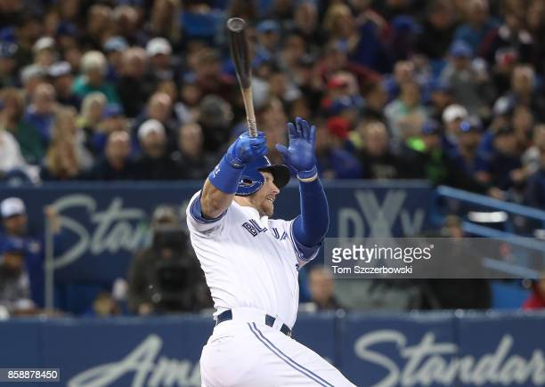 Justin Smoak of the Toronto Blue Jays hits a single in the sixth inning during MLB game action against the Detroit Tigers at Rogers Centre on...
