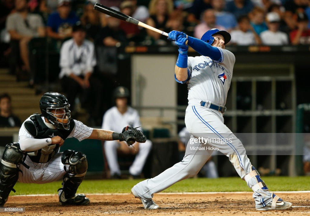 Justin Smoak #14 of the Toronto Blue Jays hits a two run homer in the fifth inning against the Chicago White Sox at Guaranteed Rate Field on August 1, 2017 in Chicago, Illinois.