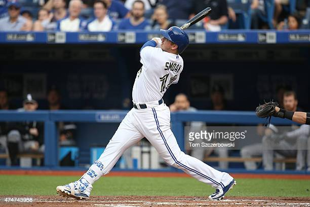 Justin Smoak of the Toronto Blue Jays hits a tworun home run in the first inning during MLB game action against the Chicago White Sox on May 25 2015...
