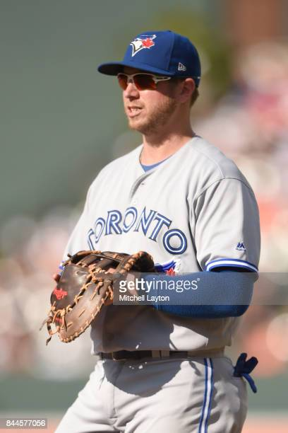 Justin Smoak of the Toronto Blue Jays looks on during a baseball game against the Baltimore Orioles at Oriole Park at Camden Yards on September 3...