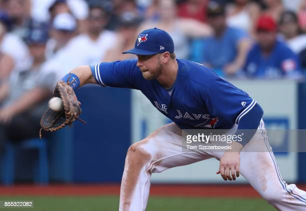 Justin Smoak of the Toronto Blue Jays records a putout at first base in the sixth inning during MLB game action against the New York Yankees at...