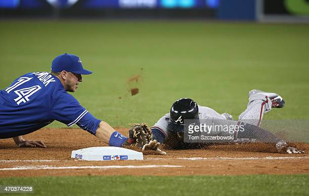 Justin Smoak of the Toronto Blue Jays tags out Cameron Maybin of the Atlanta Braves as he tries to dive back to first base to complete a double play...