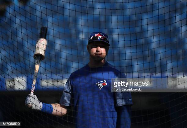 Justin Smoak of the Toronto Blue Jays warms up during batting practice before the start of MLB game action against the Baltimore Orioles at Rogers...