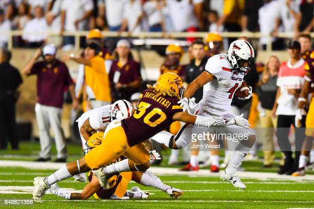 Justin Stockton of the Texas Tech Red Raiders tries to get by Dasmond Tautalatasi of the Arizona State Sun Devils during the game on September 16...