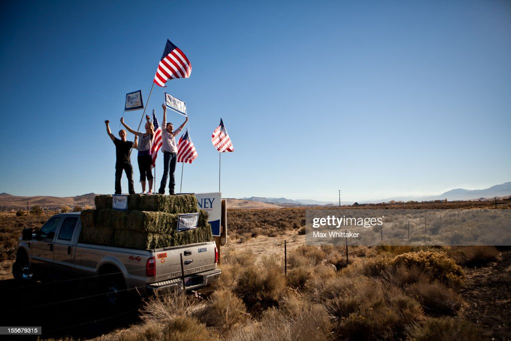 Justin Stucki, Leah Quirk, and Kenady Pettingill urge drivers to vote for U.S. Presidential candidate, former Massachusetts Governor Mitt Romney on November 6, 2012 in Spanish Springs, Nevada. As Americans go to vote, President Barack Obama and Republican nominee former Massachusetts Gov. Mitt Romney remain in a virtual tie in the national polls.