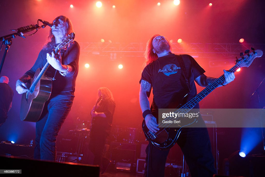 Justin Sullivan and Ceri Monger of New Model Army perform on stage at The Forum on December 12 2014 in London United Kingdom