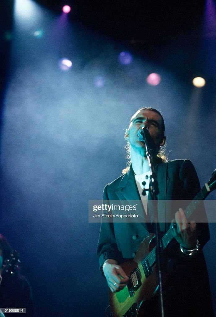 Justin Sullivan of New Model Army performing on stage at the Wembley Arena in London on the 19th January 1991