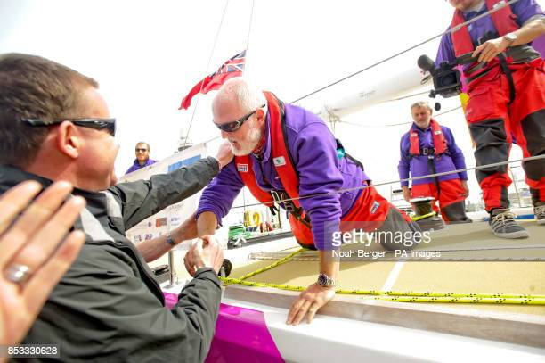 Justin Taylor left race director for Clipper Round the World Yacht Race greets British sailor Andrew Taylor as the Derry~Londonderry~Doire arrives in...