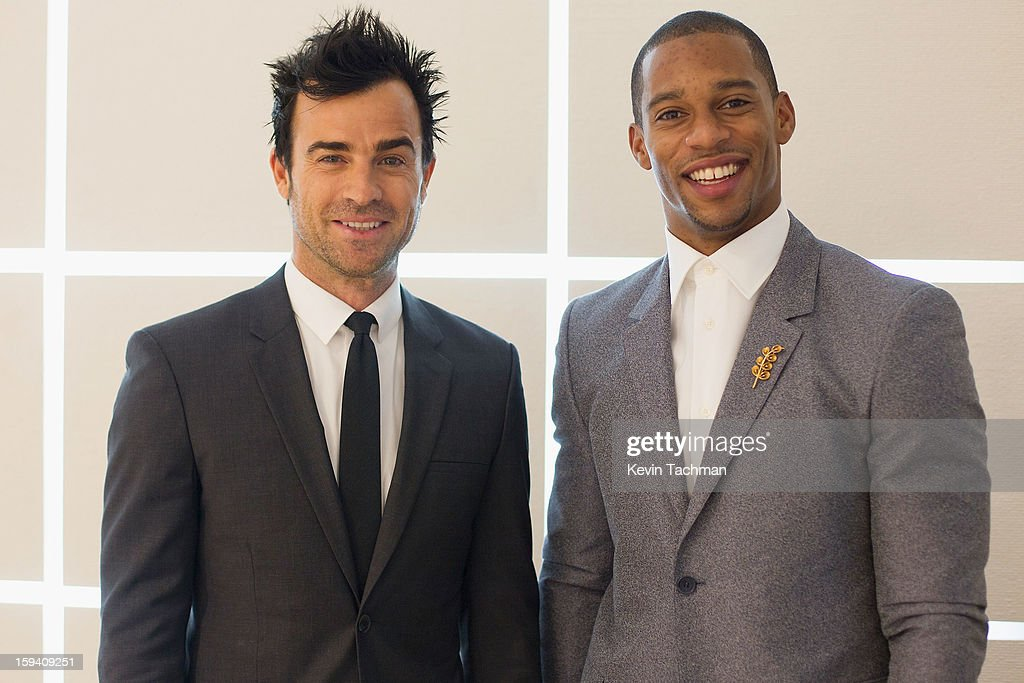 Justin Theroux (L) and Victor Cruz pose backstage prior to the Calvin Klein Collection show as part of Milan Fashion Week Menswear Autumn/Winter 2013 on January 13, 2012 in Milan, Italy.