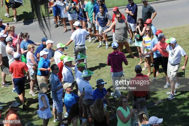 Justin Thomas and Dustin Johnson walk to the course during the second round of THE PLAYERS Championship on THE PLAYERS Stadium Course at TPC Sawgrass...