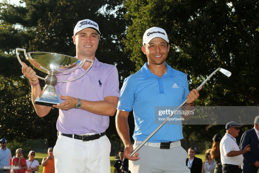 Justin Thomas and Xander Schauffele hold up their trophies after the final round of the PGA Tour Championship on September 24, 2017 at East Lake Golf Club in Atlanta, Georgia.