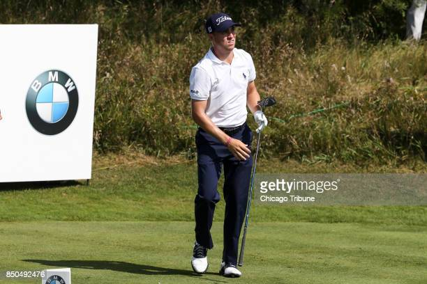 Justin Thomas looks on after hitting from the 14th tee during the first round of the BMW Championship on September 14 at Conway Farms Golf Club in...