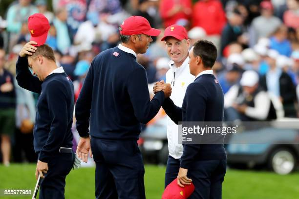 Justin Thomas Matt Kuchar Captain's assistant Jim Furyk and Rickie Fowler of the US Team celebrate on the 18th green after Fowler and Thomas halved...