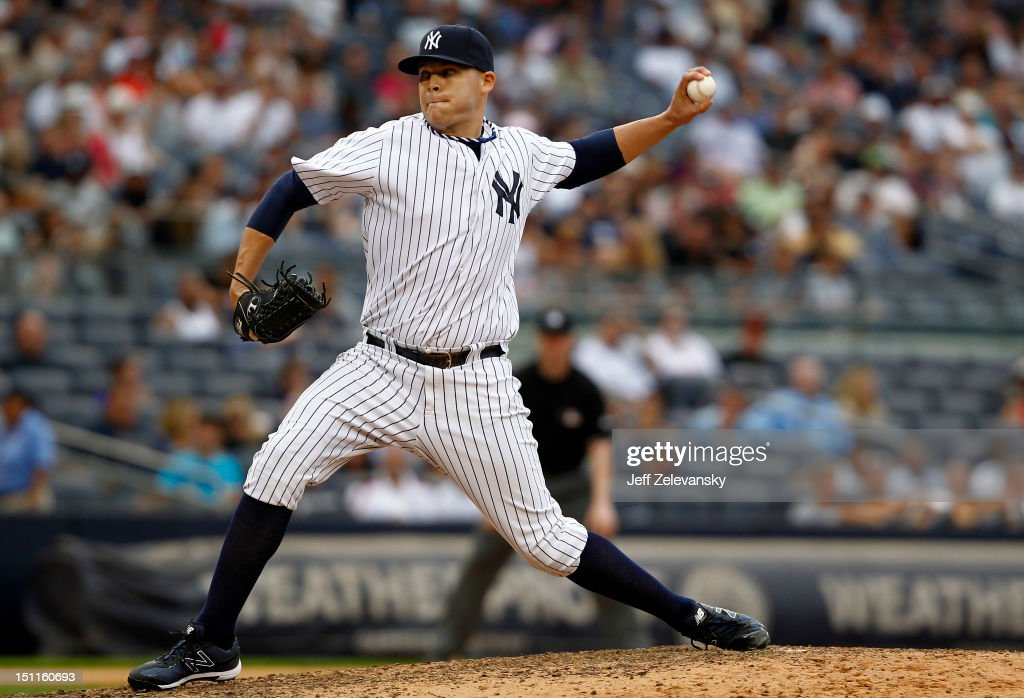 Justin Thomas #63 of the New York Yankees delivers against the Baltimore Orioles at Yankee Stadium on September 2, 2012 in the Bronx borough of New York City.