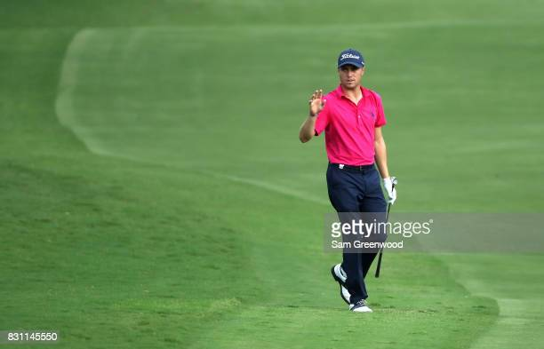 Justin Thomas of the United States acknowledges the crowd on the on the 18th hole during the final round of the 2017 PGA Championship at Quail Hollow...
