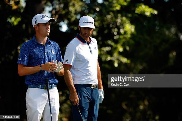 Justin Thomas of the United States and Dustin Johnson of the United States prepare to play from the second tee during the first round of the 2016...