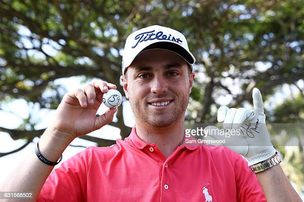 Justin Thomas of the United States celebrates after scoring a 59 during the first round of the Sony Open In Hawaii at Waialae Country Club on January...