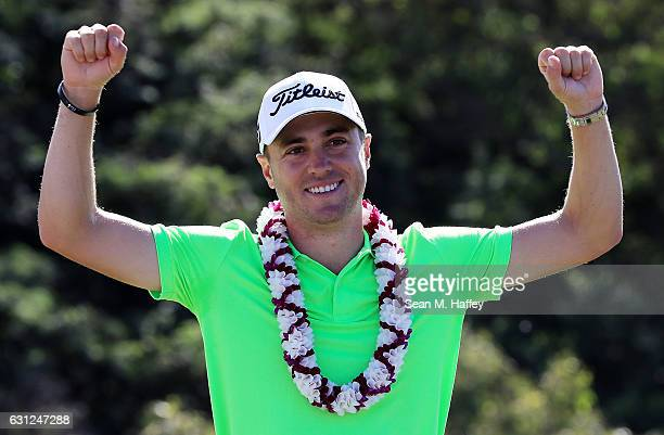 Justin Thomas of the United States celebrates on the 18th green after winning during the final round of the SBS Tournament of Champions at the...