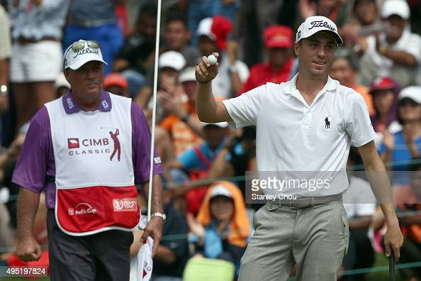 Justin Thomas of the United States celebrates on the 18th hole after winning during round four of the CIMB Classic at Kuala Lumpur Golf Country Club...