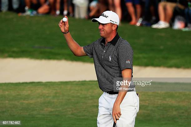 Justin Thomas of the United States celebrates winning on the 18th green after the final round of the Sony Open In Hawaii at Waialae Country Club on...