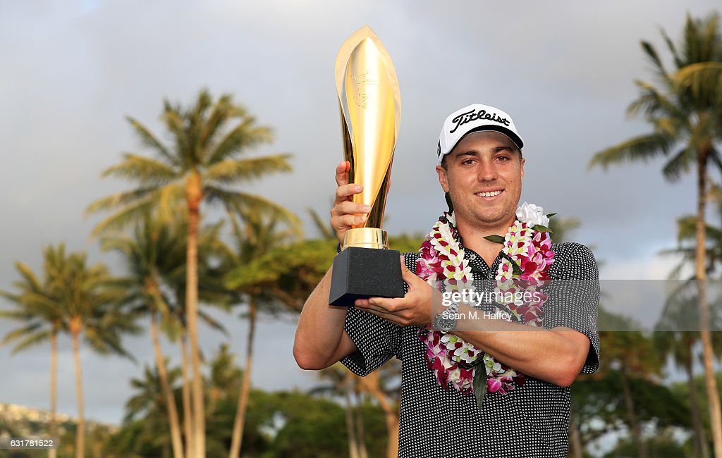 Justin Thomas of the United States celebrates with the trophy after winning the Sony Open In Hawaii at Waialae Country Club on January 15, 2017 in Honolulu, Hawaii.