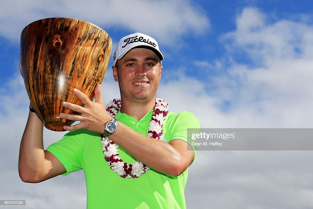 Justin Thomas of the United States celebrates with the trophy on the 18th green after winning during the final round of the SBS Tournament of Champions at the Plantation Course at Kapalua Golf Club on January 8, 2017 in Lahaina, Hawaii.