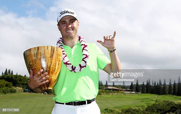 Justin Thomas of the United States celebrates with the trophy on the 18th green after winning during the final round of the SBS Tournament of...