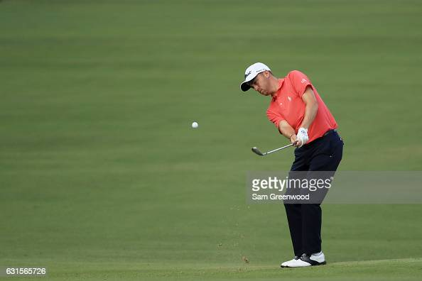 Justin Thomas of the United States chips in for eagle on the tenth hole during the first round of the Sony Open In Hawaii at Waialae Country Club on...