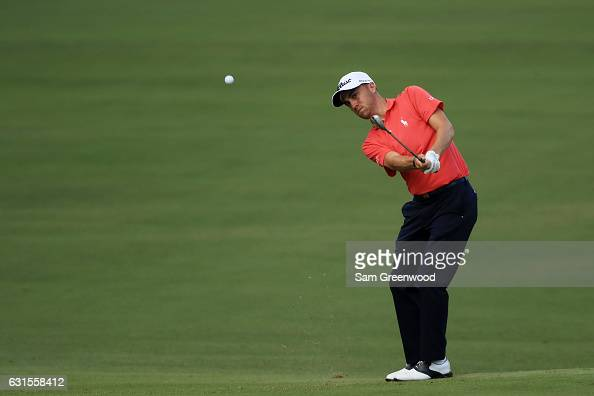 Justin Thomas of the United States chips in on the tenth hole during the first round of the Sony Open In Hawaii at Waialae Country Club on January 12...