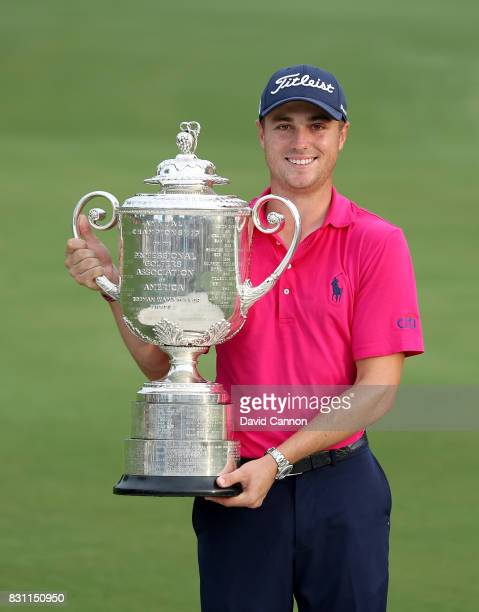 Justin Thomas of the United States holds the Wanamaker Trophy at the presentation after the final round of the 2017 PGA Championship at Quail Hollow...