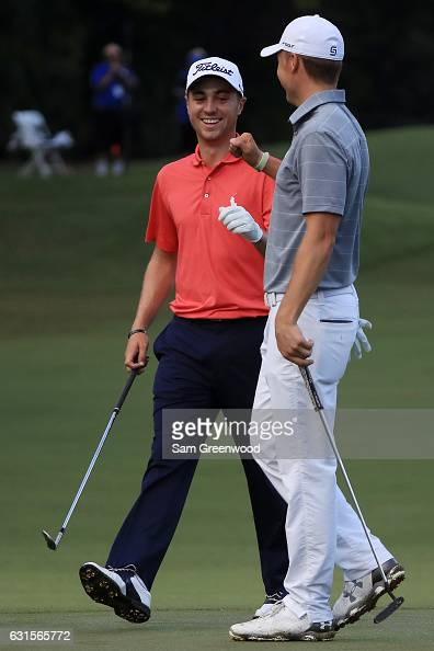 Justin Thomas of the United States is congratulated by Jordan Spieth of the United States after chipping in for eagle on the tenth hole during the...