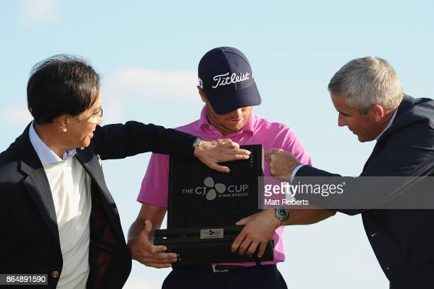 Justin Thomas of the United States Lee Jay Hyun and Jay Monahan look at the trophy during the CJ Cup at Nine Bridges on October 22 2017 in Jeju South...