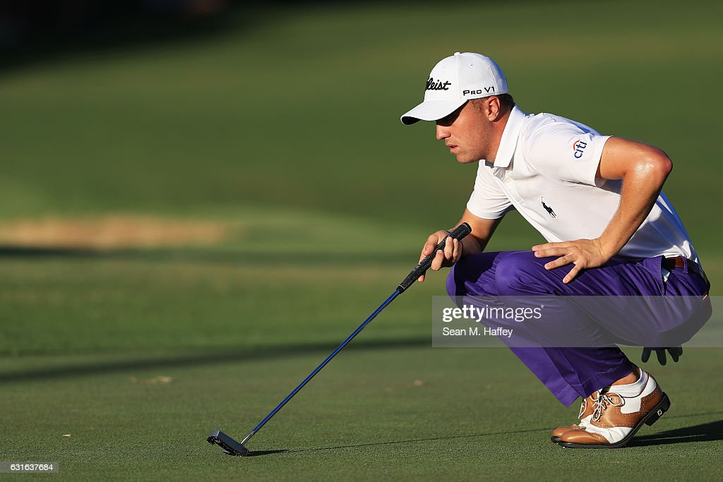 Justin Thomas of the United States lines up a putt for eagle on the 18th green during the second round of the Sony Open In Hawaii at Waialae Country Club on January 13, 2017 in Honolulu, Hawaii.