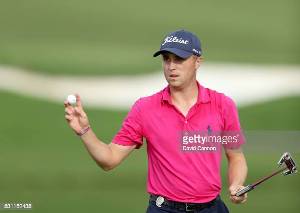 Justin Thomas of the United States makes a par putt on the par 4 16th hole during the final round of the 2017 PGA Championship at Quail Hollow on...